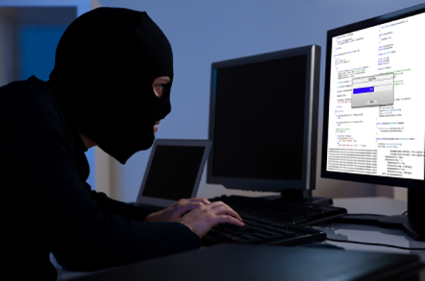 Hacker downloading information off a computer